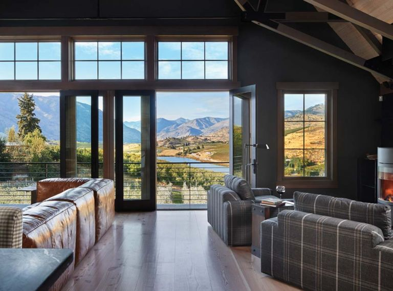 "The great room of Tracey and Charlie Brown s barn home opens onto vistas of Lake Chelan. The Stûv wood burning stove warms the great room; 16"" to 18"" wide Dinesen flooring is fabricated from old growth Douglas fir."