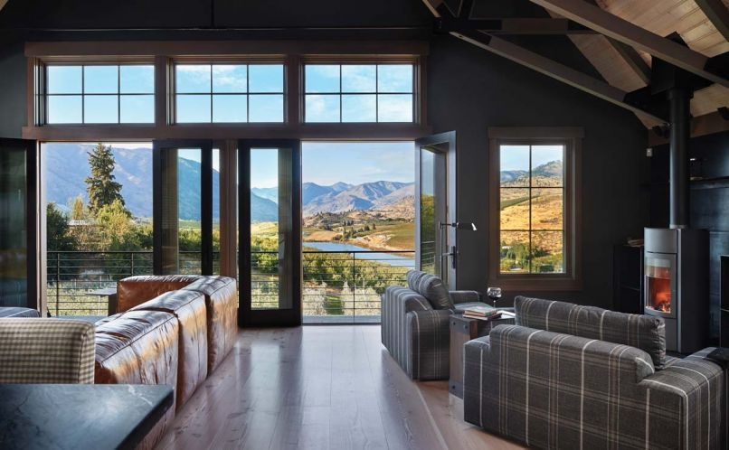 "The great room of Tracey and Charlie Brown's barn home opens onto vistas of Lake Chelan. The Stûv wood burning stove warms the great room; 16"" to 18"" wide Dinesen flooring is fabricated from old growth Douglas fir."