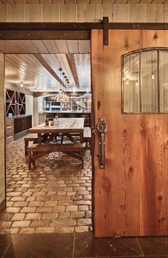 Charlie, contractor Sam Beazley of Beazley Construction, and Pedro Valdez, Beazley's lead carpenter, tackled the wine cellar design. To create a more rustic look, they used imported split sanded cobblestones - once used as ballast in ships sailing to Colonial America - as the flooring.