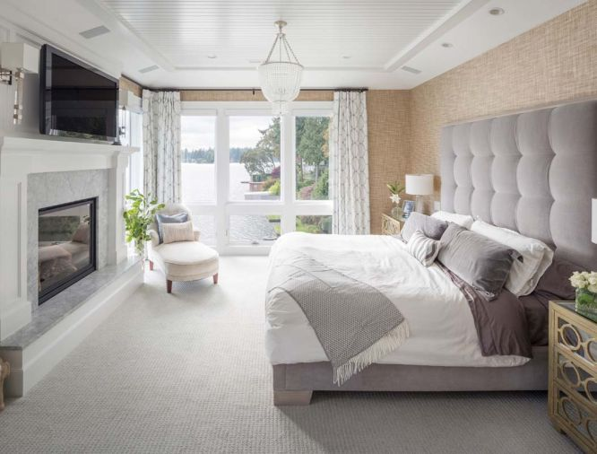 The master bedroom features an ensuite fireplace as well as soft, plush detailing to create a sanctuary-like atmosphere.
