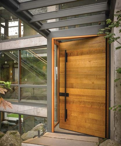 Drawing inspiration from the human history of the Bellingham area, McClellan selected a cedar slab textured with a hand adze, a traditional Native American carpentry tool, for the front door.