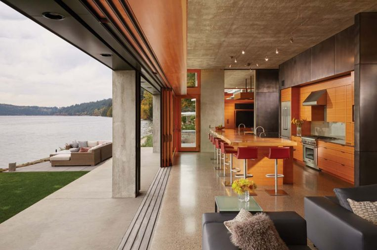 "The main living area is separated from the water by a 40-foot long lift-and-slide door; when open, it creates 30 feet of uninterrupted direct access to the outdoors. ""When you open those doors, you get this amazing sea breeze, and all you hear is the lap of the waves,"" says McClellan. ""It's just like you're sitting at the beach."""