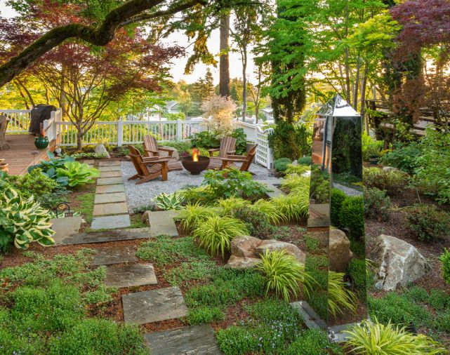To design a modern yard to complement a traditional home, a Seattle landscape is created with elements that combine the homeowner's Virginia childhood with plants native to the Northwest.