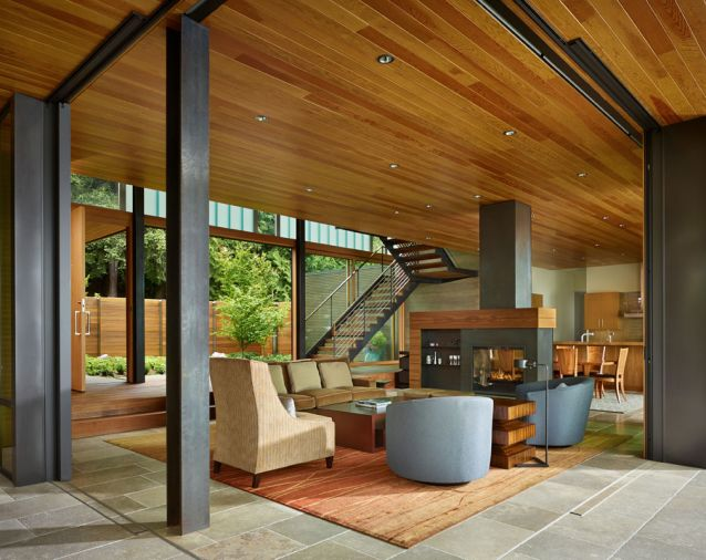 A courtyard defines the first of several spaces leading to the lake. Contrasting finishes differentiate the various wood species. Windows were supplied by Sierra Pacific Windows.