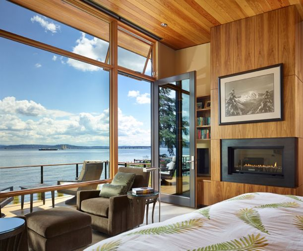 aster bedroom with built-in fireplace, private deck overlooking lake.
