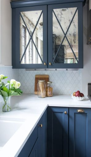 Glossy countertops, distressed mirrors on upper cabinets.