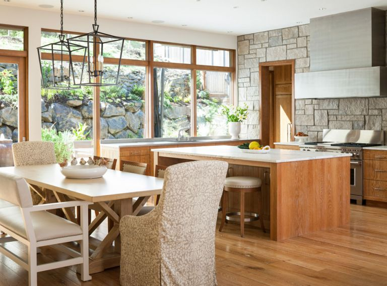 Borrowing design concepts from Italian farmhouses and classic Northwest contemporary, Susan and Paul designed a kitchen that maximizes every bit of that precious Seattle light. Full-length windows behind the sink let in abundant sun from morning till evening, and afford views of a terraced rock garden planted with native and Mediterranean plants. Fully custom cabinets 