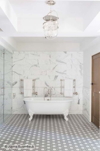 Master bath features handcrafted New Ravenna floor tiles and marble backsplash via Ann Sacks.