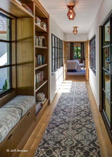 To preserve the character of the architecture, Brachvogel designed a sunlit corridor, with windows on both sides, that leads from the main house to the 1200 sq. ft. Master Bedroom and Bath addition.