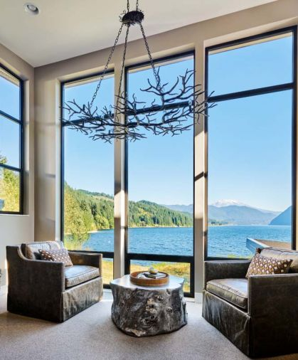 A spectacular Rainforest Chandelier by Currey & Co frames the view, below are swivel-style leather waterfall chairs by GHID.
