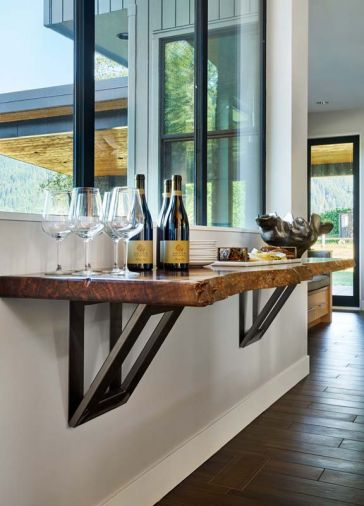 Tiffany Webber designed a floating service bar with a live walnut edge and oversized supporting brackets.