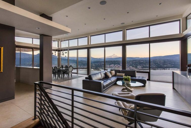 A horizontal cloud was added as an architectural feature to counteract the tall vaults at the main living area/entry, where a bridge connects the upper guest parking area with the living room, and the spectacular view of Mt. Hood beyond.