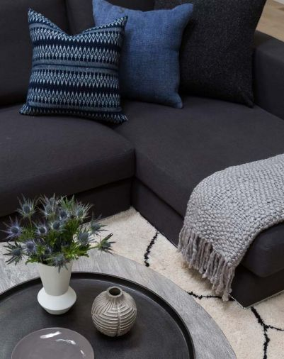 Accessories like the pillows from Tasdemir Rugs on Bainbridge Island help add texture to the living room.
