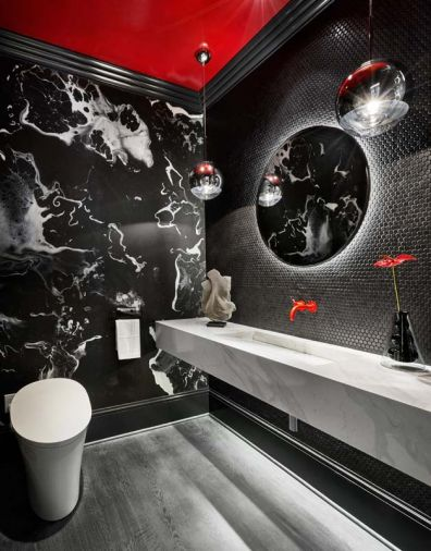 Topographic black wall-paper adds movement to the red-dominated powder room.