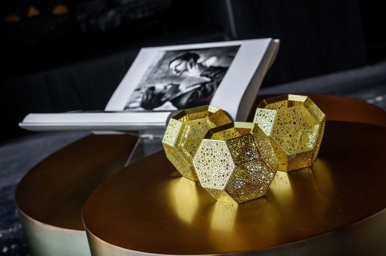 Tom Dixon gold candle holders cast fascinating golden light adding intimacy to late night conversations.