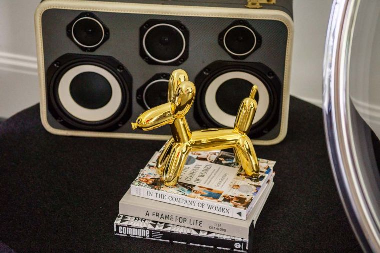 Jeff Koons gold balloon dog prances before Ezra Cimino-Hurt black and white Case of Bass boombox.