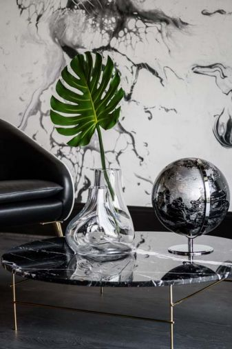 Spanish imported marble top table echoes wallpaper.