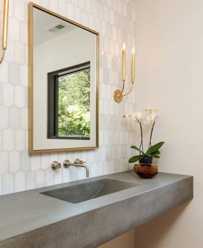 Powder room countertops with integrated sink, and white marble background. Cement custom made by Cement Elegance.