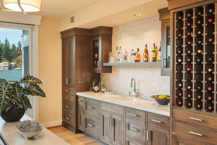 Oak Grove Cabinets pop against a Porcelanosa Lines Mini Strip Grey tile backsplash.