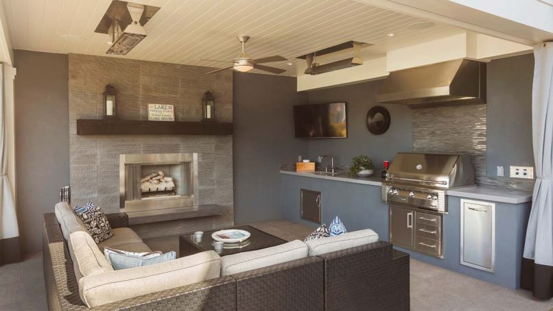 The outdoor room includes heat lamps for coziness, and porcelain tile floor. Fireplace face from Stone Source Inca Gray chiseled echoes BBQ backsplash of Pental bluestone Natural split plus mosaic. A smaller BBQ area located on deck off kitchen for dinners for two.