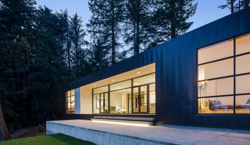 The simple, rectangular shape of the home is clad in metal siding for a clean, unadorned look.