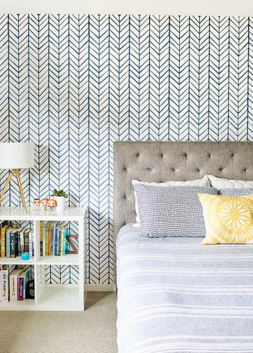 "Detailed geometric wallpaper is used in multiple locations in the home, including one of the children's bedrooms and the powder room. ""Coming from the white, gallery-like halls and encountering a striking, textural pattern really makes it feel like a special space,"" says Jenny."