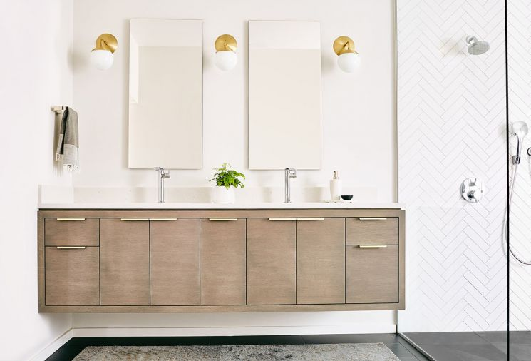 "An open, spacious master bathroom layout brings serenity to the morning routine. ""These homeowners wanted a very open room, which was in part a reaction to the former bathroom they were using, which had a tiny, compartmentalized shower,"" says Jenny. The custom floating vanity was manufactured locally."
