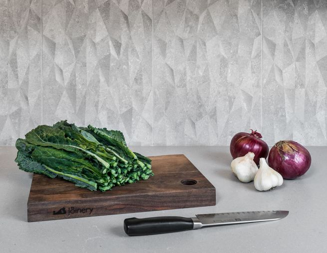 Ceramic backsplash tiles add a naturalistic texture without the porosity of stone, which can be hard to clean.