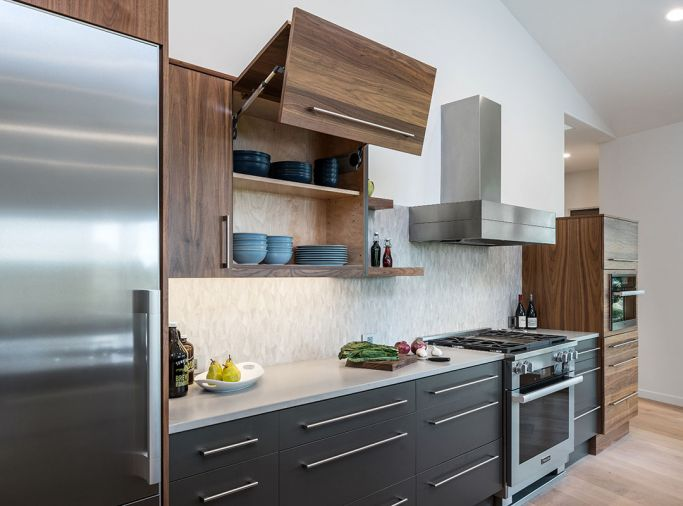 A fold-up door gives the homeowners easy access to contents while cooking without the cabinet door getting in the way.