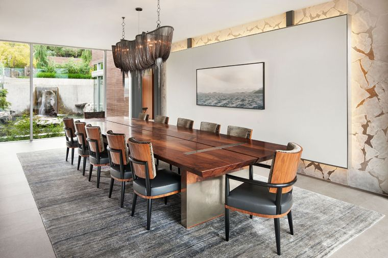 Atlantis blackened nickel jewelry chainmail chandelier by Terzani crowns the GCW custom walnut dining table and chairs with nickel accents. GCW floating fused glass wall dampens noise during large dinner parties.