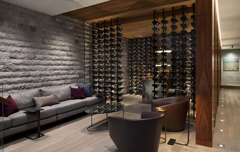 "Individual LED lights illuminate each bottle of wine. ""The negative space between bottles was an important way to display the client's best wines,"" says Garret."