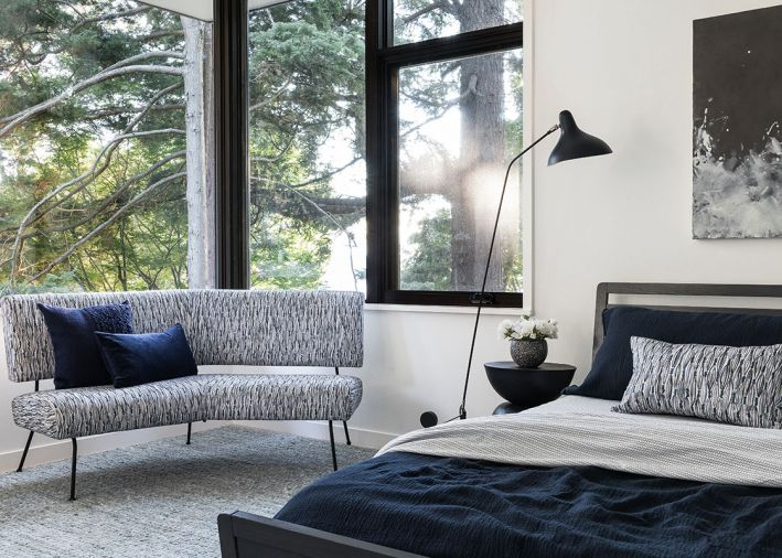 In the upstairs bedrooms, slightly darker blue tones are used to create a calming effect while continuing to reference the brilliant blues downstairs.