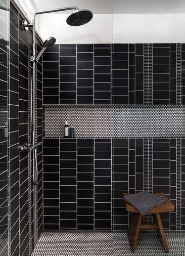 "In the master bath shower, one of the homeowners used her graphic design skills to create a custom tile layout using simple charcoal glaze ceramic tile. ""I wanted something that wasn't overly symmetrical and that had a good sense of movement to it,"" says the homeowner. ""It's fun that I was able to put my stamp on something."""