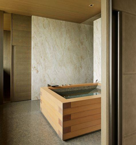 Hunziker custom closet door with metal pull echoes wooden Japanese soaking tub.