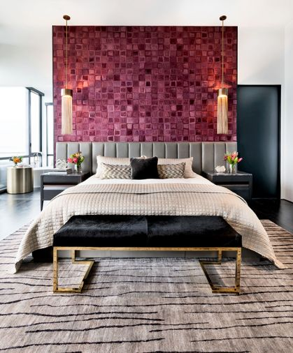 Kyle Bunting pink cowhide wallcovering crowns gray channel back Restoration Hardware headboard and HBB Studio nightstands. Black cowhide and brass bench by Worlds Away. Mombasa Rug by Feizy Rugs.