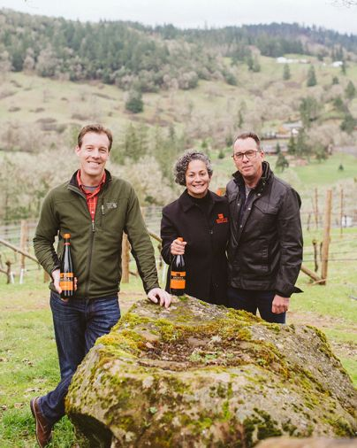 Associate Winemaker Wade Smith with Gloria and Stephen Reustle of Reustle Prayer Rock Vineyards.