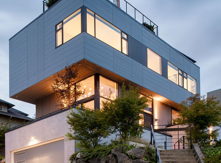 A super-steep, relatively small site brought challenges, but also opportunity. Instead of building out, this home went up to fit just over 3,000 square feet on a city lot. Terraced walkways, patios, and staircases knit the home into the landscape, and the offset cantilevered form creates plenty of opportunities for rooftop outdoor space.
