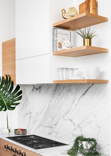 The same Carrera marble used for the countertops was also employed as a backsplash behind the Wolf range.