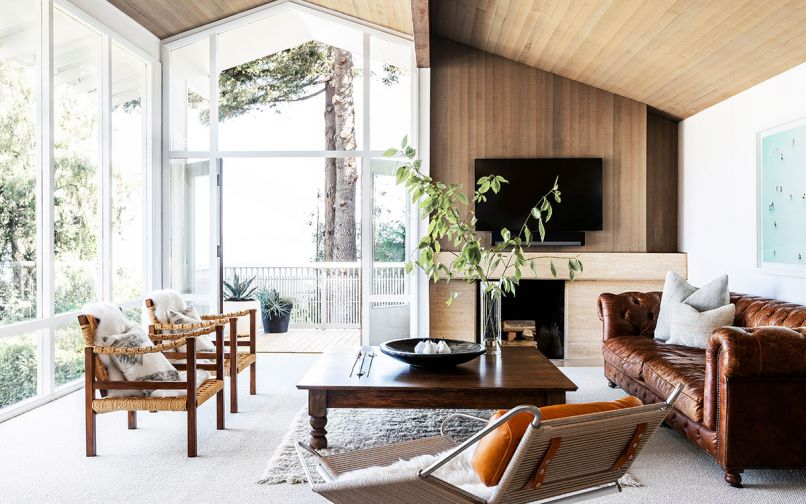 The remodel retained many of the classic midcentury components of the home, like an offset fireplace and the wood paneled ceiling.
