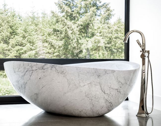 A marble Papillon Stone Forest bathtub with Brizo Virage Tub Filler adds soft lines to master bath.