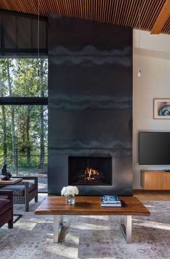 Miller glued hot-rolled steel plates to plywood to form the fireplace.
