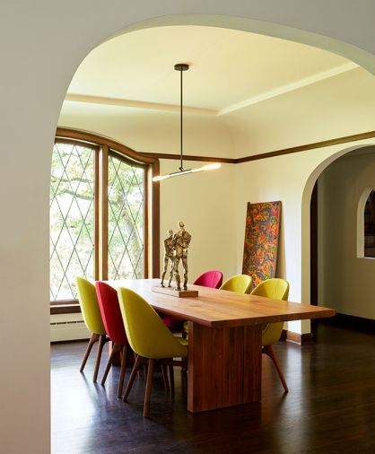 A new arched opening replaced the efficiency dining room door. Christopher Boots' Simple Negative pendant light illuminates Solo chairs by Neri & Hu for De La Espada.
