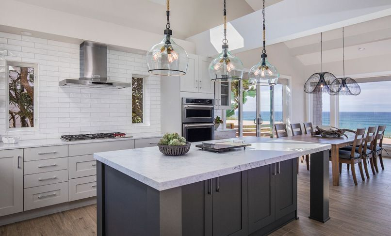 "Paramount for the kitchen of this Gleneden Beach retreat was to merge the indoors and out, and to lighten a once dark, cavelike feel. ""The challenges were to create a large open space and maintain the structural integrity of the loft above,"" says C&R Design Remodel co-owner Beth Rhoades. ""This required beams over the kitchen's new location. We also needed to address the cooktop ventilation. The end result was to sheetrock those to have them disappear in the space."""