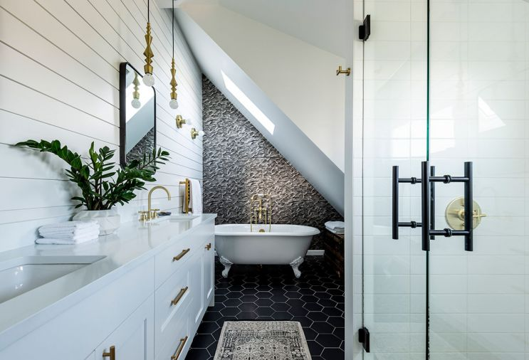 "The wallpapered wall behind the tub in the master bathroom hides a hidden door leading to more storage. ""Sometimes a really intricate pattern can help conceal things,"" says Jeff."