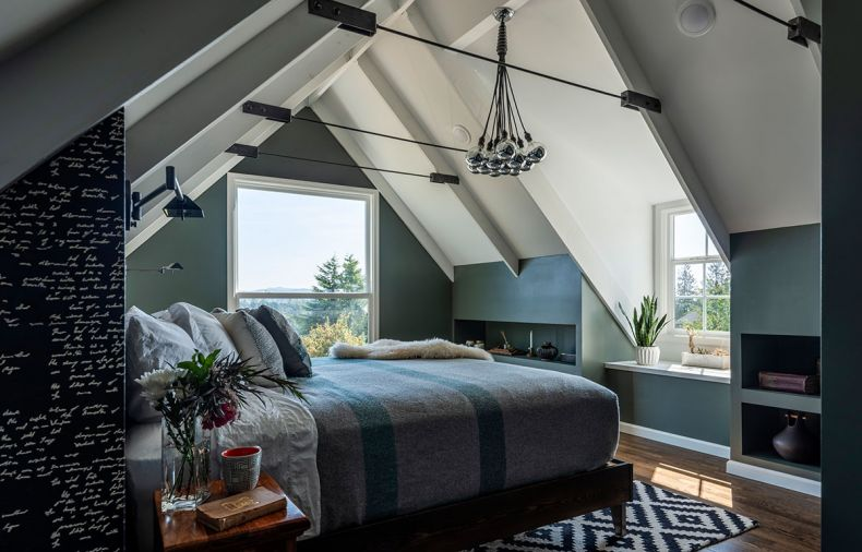 In the master bedroom, wall-mounted lamps on each side of the bed provide light for reading without taking up valuable bedside table real estate. In rooms with steeply sloping ceilings, built-in shelving along the low edges turns space that might be wasted into valuable storage.