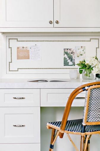 In the kitchen, recipes and lists can be reviewed at the built in desk. A Parisian chair echoes its stool brethren at the island.