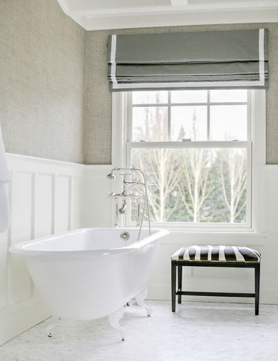 A claw-foot tub and zebra stool bring old world elegance to a first floor full bath.