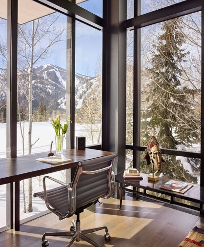 DeGennaro's office overlooks a snowy landscape framed by structural steel and glass by Fleetwood Windows. African mask is a memento from DeGennaro's African trip.