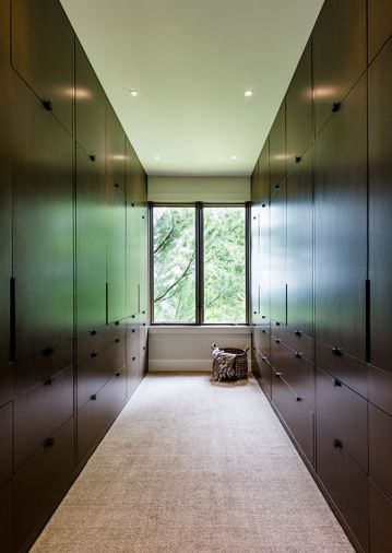 To maintain visual flow from room-to-room, warm Douglas fir wood with custom stain was used on the newly crafted master closet, with hanging space above and drawers below – for a tidier, clutter-free look.