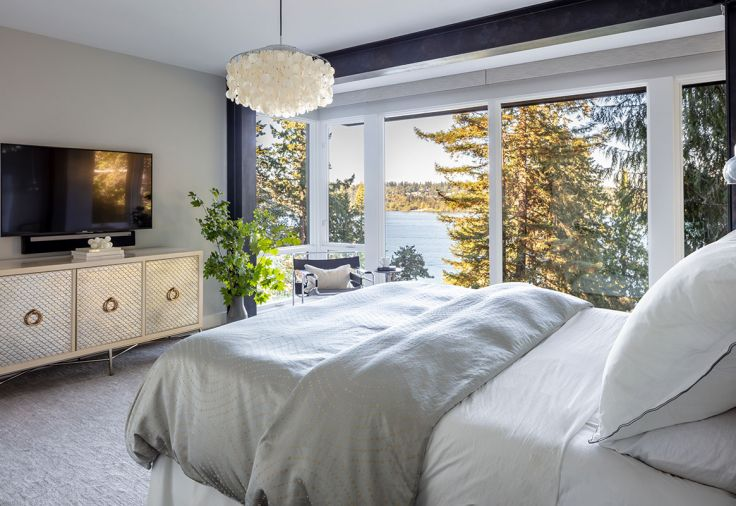Master bedroom features energy efficient Sierra Pacific windows and doors opening onto Moon's desired treehouse effect.